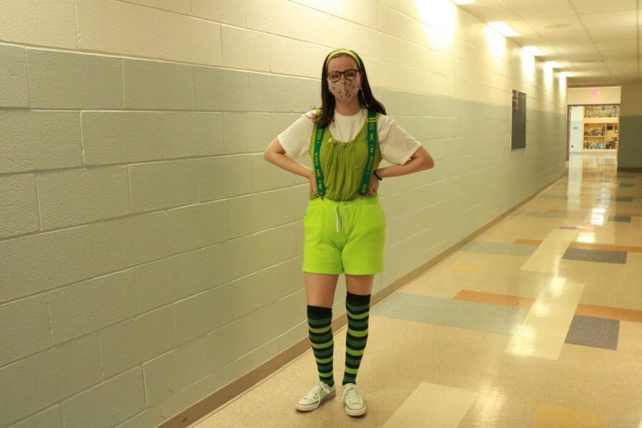 Junior Shea McGraw poses in Irish apparel for homecoming week on Wednesday Oct. 14.