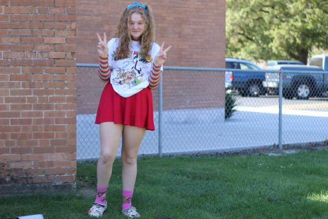 "Sophomore Margaret Noblitt poses on homecoming week while dresseing to the theme ""Stags for Life."""