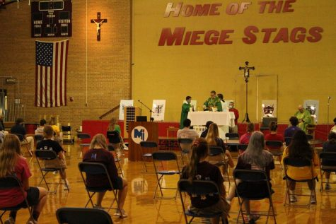 Seniors gather in gym to celebrate Mass with Archbishop on Oct. 21.