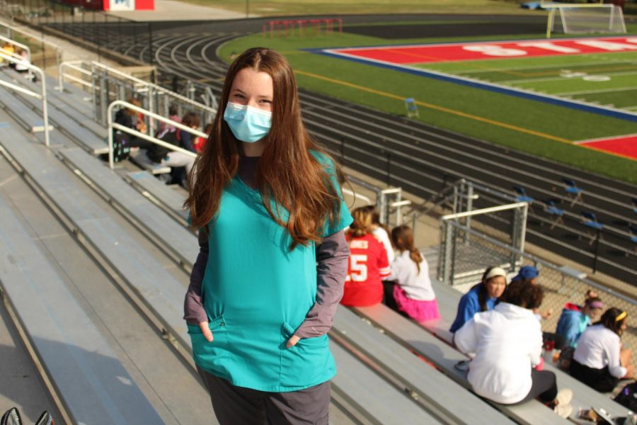 Sophomore Amelie Robinson wears nurse attire for the homecoming theme