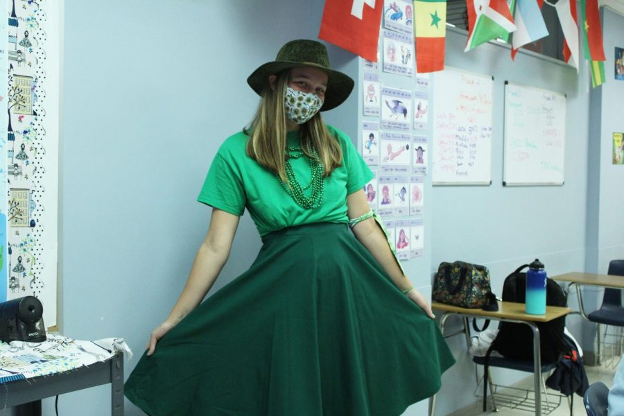 Senior Maggie Masoner wears green to show her pride for the Martina Herd for the homecoming theme