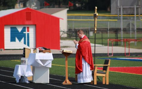 Father Anthony Mersmann says the first Mass of the school year outside. As a new member of the staff, this was Mersmann's first time giving Mass at Miege, and due to the pandemic, it brought challenges for CMT.