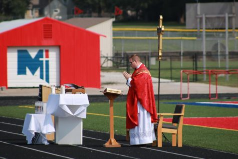 Father Anthony Mersmann says the first Mass of the school year outside. As a new member of the staff, this was Mersmann