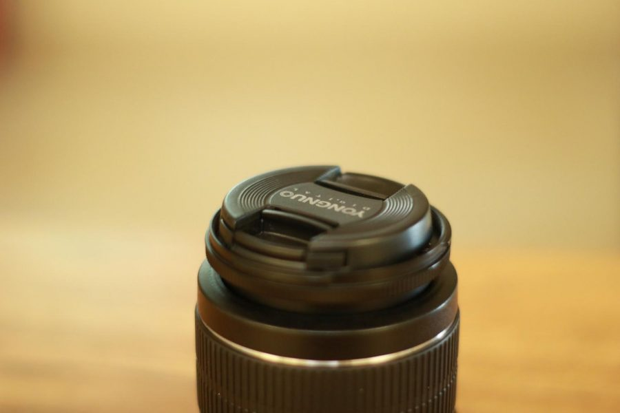 Close up of a camera lens that is ready to be put in action.