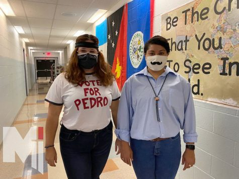 Math teachers Taryn Frank and Kat Kennedy pose as  Napoleon Dynamite and Pedro. They both said they enjoyed dressing up together and having people see their costumes.