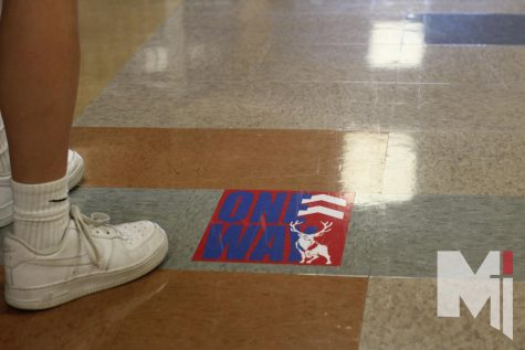Miege has one-way hallway signs all over school to show the way. According to theology teacher Ross Dessert, this policy is recommended by the CDC and the Department of Education.