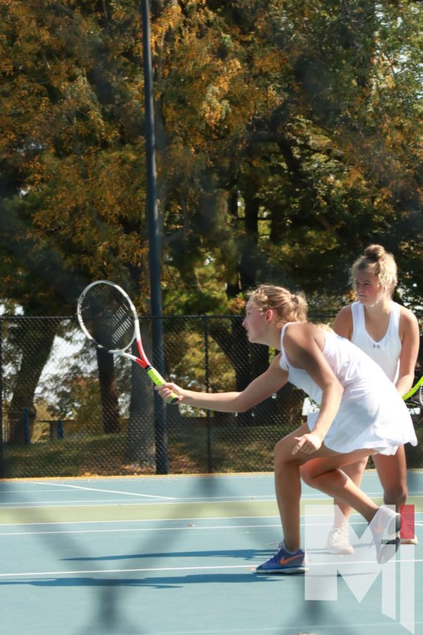Senior Delaney Pepin and Freshman Livi Shull play the net during a doubles match at Regionals.