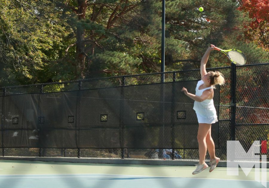 Freshman Livi Shull serves during a doubles match at Regionals.