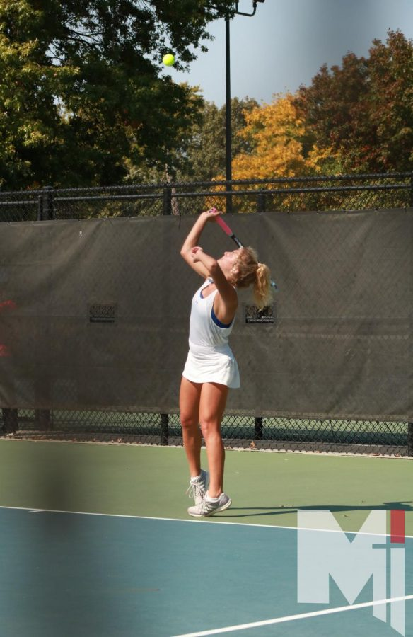 Senior Mariel Allen serves while competing in her first singles match at Regionals.