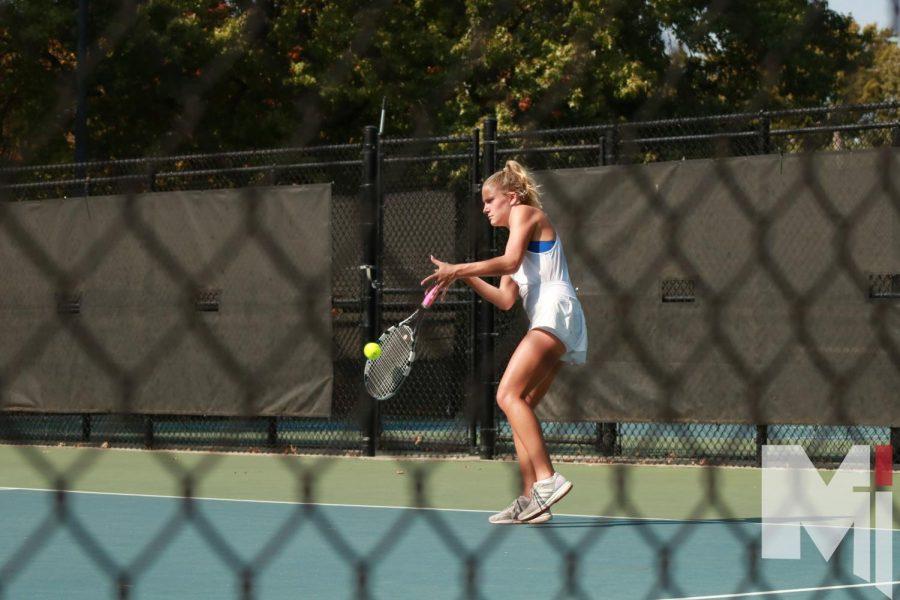 Senior Mariel Allen swings at a ball against her opponent at Regionals.