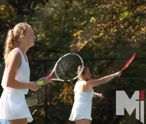 Senior Delaney Pepin and Senior Olivia Hayward warm up before their matches at Regionals.