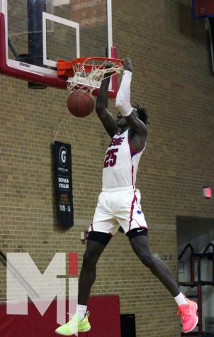 Junior Mark Mitchell goes up for a dunk for a 68-37 victory against Shawnee Mission North for the Stags' first game.