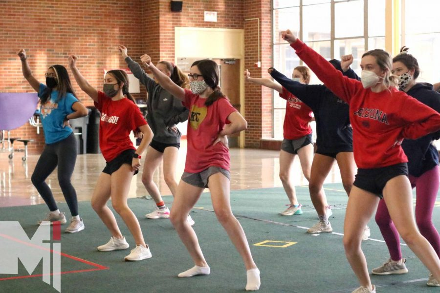 The varsity dance team practices a new hip-hop routine choreographed by assistant coach Natalie Hogue at North Campus for an upcoming virtual 4A competition.