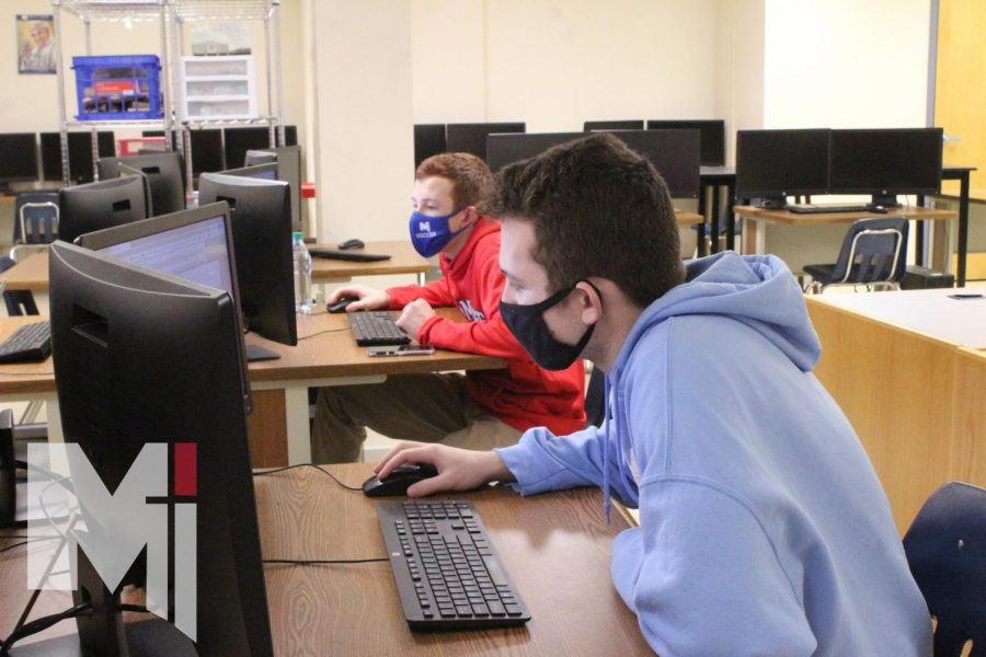 Freshman Patrick Watson and junior William Watson log onto their computers on Jan. 14 to compete in the cybersecurity challenge. Every Thursday, the STAGS Who Code club meets to learn new programs and compete in the competitions.