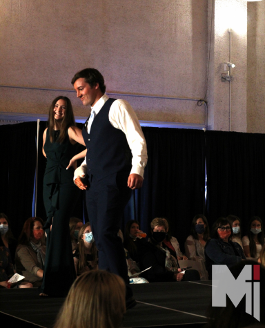 """Posing at the end of the cat walk, Mia Putnam and Max Heller showed off their """"night-out"""" outfits."""