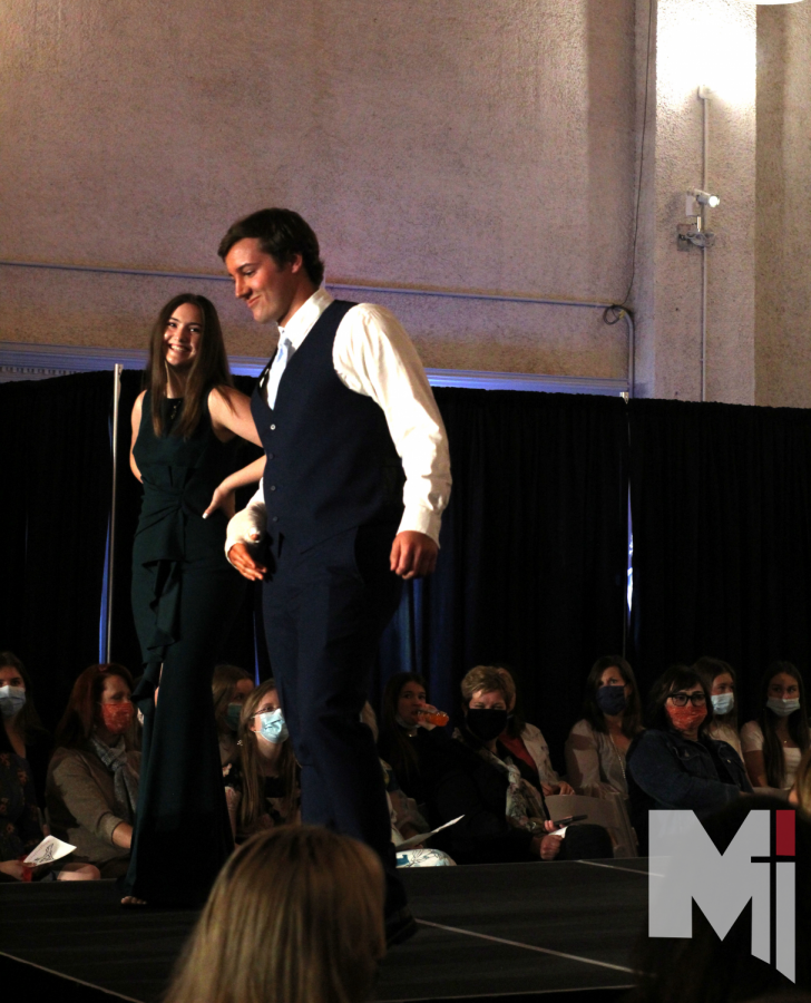 Posing at the end of the cat walk, Mia Putnam and Max Heller showed off their
