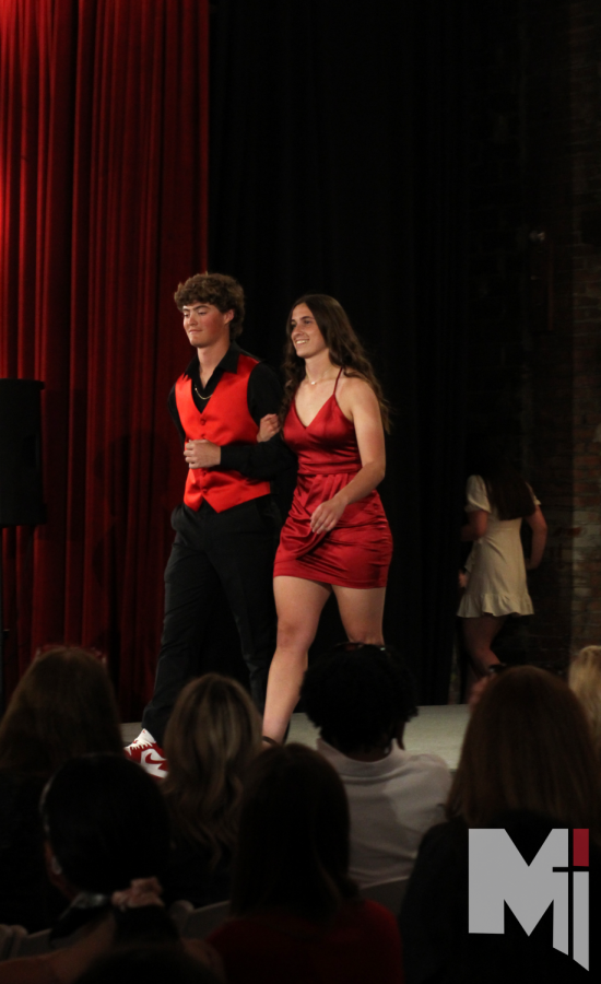 Strutting down the runway, Cate Boiling and Logan Shull show off their fierce outfits.