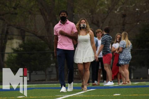 Seniors Timmy Dorsey and Layne Fortin are introduced as Prom Court nominees as they walk down the field. The 2021 Prom Court has been expanded to 14 seniors, to make up for the lack of Sadies Court this year.