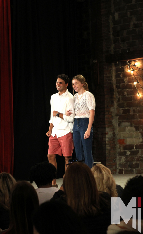 Evan Para and Merrin OConnor pose for the audience. The two linked arms before they walked together down the runway.