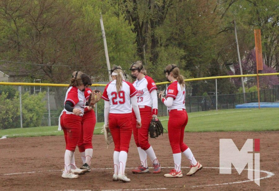 Infielders freshman Jada Gilliland, freshman Katie Kolarik, sophomore Cassidy Reno, sophomore Cameron Soldner and  junior Annika Smith meet in the pitcher's circle after striking out a McLouth batter.