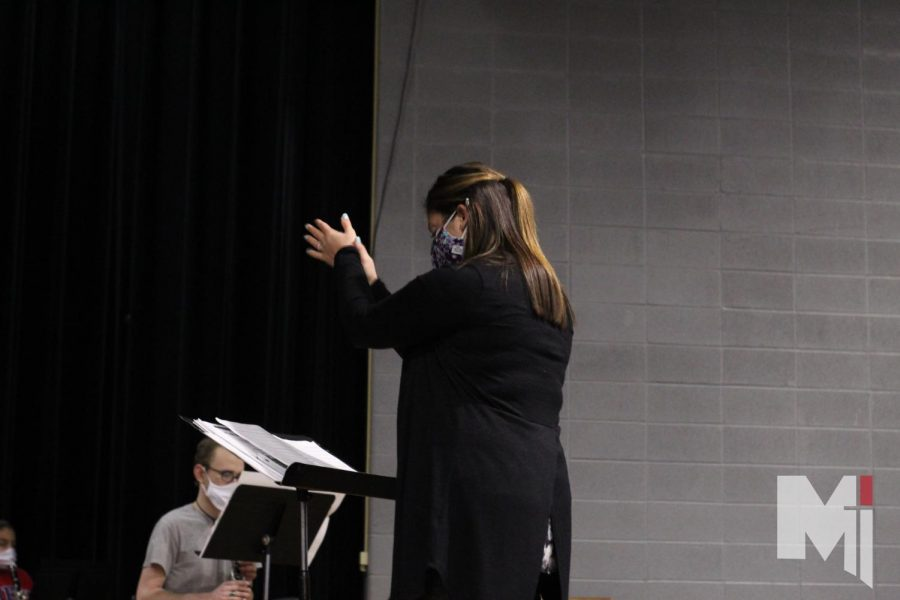 Clapping to the beat, band director Tiffany Nesbihal directs her first hour band class.