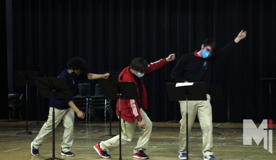 Sophomore Dawson Utt, senior Joseph Vogt, and senior Alex Vani practice their dance routine.