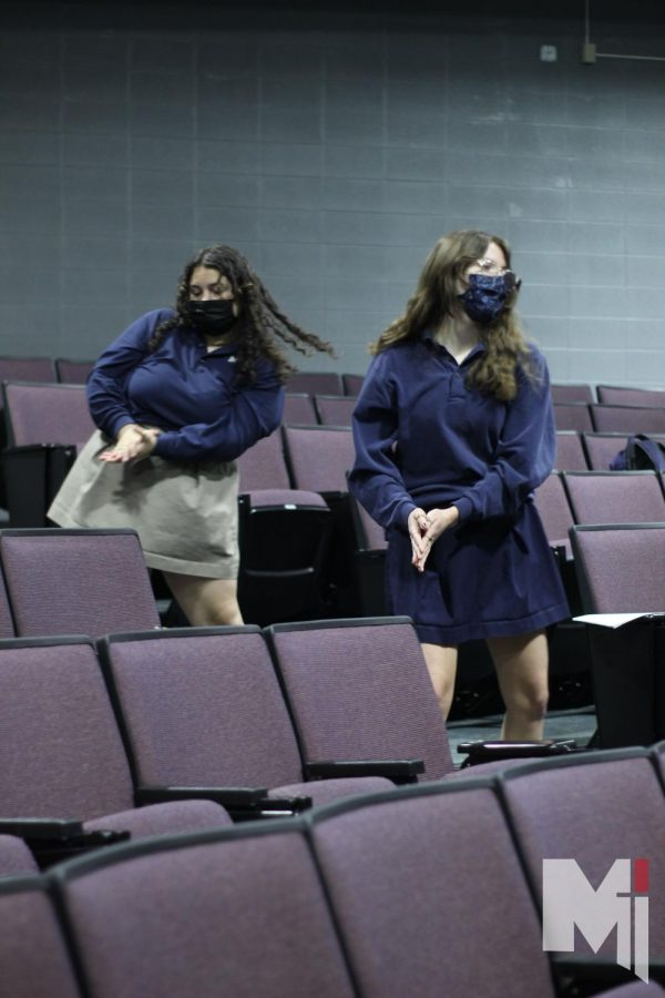 Hips swinging side to side, juniors Cara Parisi and Sophia Nordling dance their way through the music.