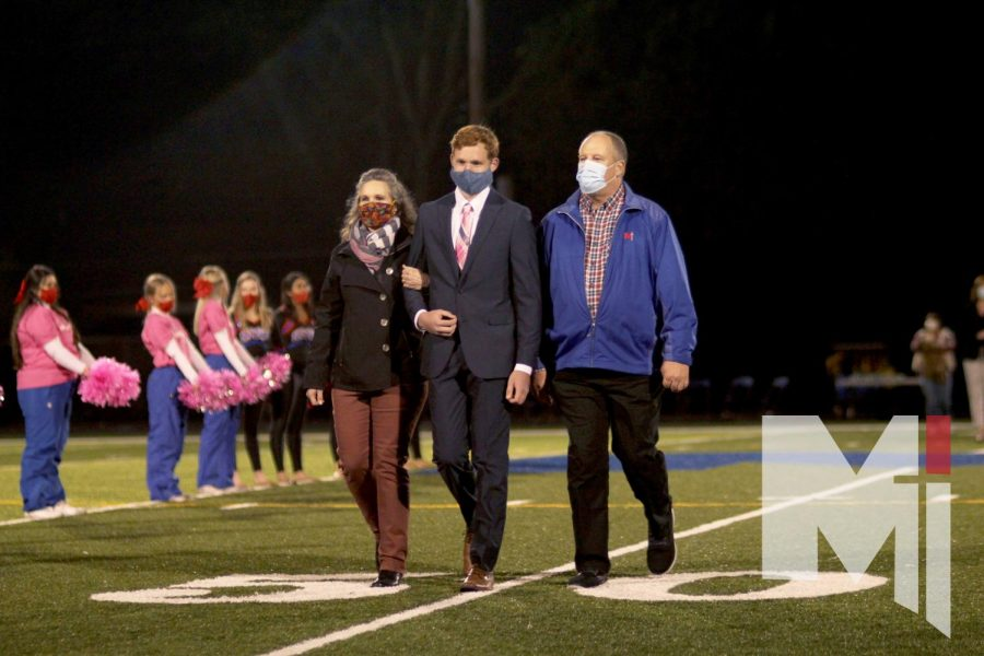 Senior Daniel Fontaine walks with his parents during this year's Homecoming football game. Daniel's mother, Jennifer (Tylicki) Fontaine was in the class of 1990, and his grandfather who was Walt Tylicki, the namesake of the Tylicki herd.