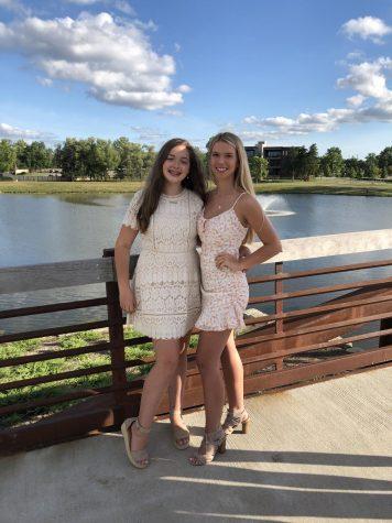 Senior Emerson Burris poses with her freshman sister Addy.