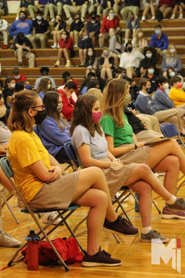 TOGETHER IN PRAYER Listening to Fr. Anthony Mersmann, seniors gather in the gym for mass on April 29. This was the last all-school Mass for the senior class.