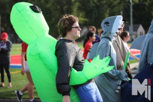 Walking steadily around the track, senior Sam Staley goes dressed as a person being carried off by an alien. The seniors were first to finish their laps and many went to get funnel cake or their Stag Strut t-shirt.