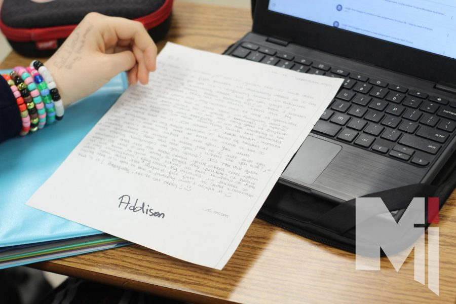 During her French III class, junior Addison Summers reads a letter from her pen-pal. Her pen-pal, Iman, introduced herself and talked about her life in Belgium.