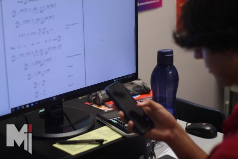 With the quick ring of a new notification, Senior Julian Gallegos ignores his calculus homework in order to respond to his friends.