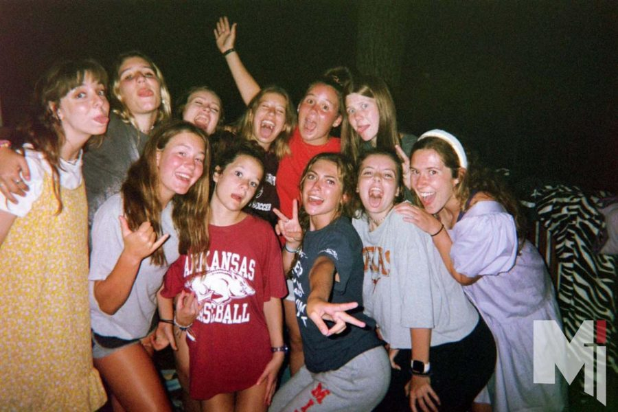 Standing+on+the+back+deck+of+the+cabin%2C+juniors+Lexi+Kurt%2C+Stella+Cahalan%2C+Claire+Winklhofer+and+Allison+Brentano+gather+with+their+cabin+at+Camp+Barnabas+as+they+smile+at+the+disposable+camera.+The+missionaries+had+just+finished+their+nightly+prayers+and+reflections.